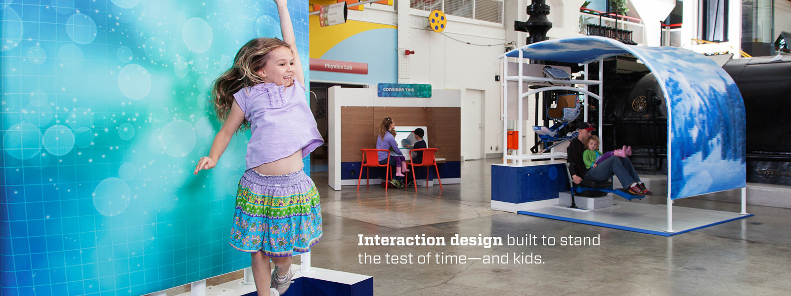 Interaction design built to stand the test of time - and kids. Girl jumping while interacting with Human Plus exhibit.