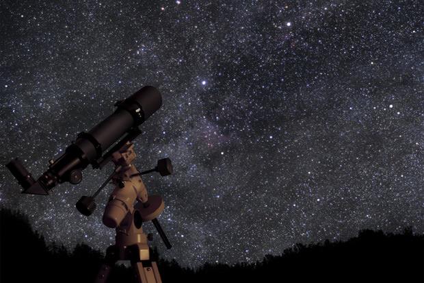 Telescope against night sky