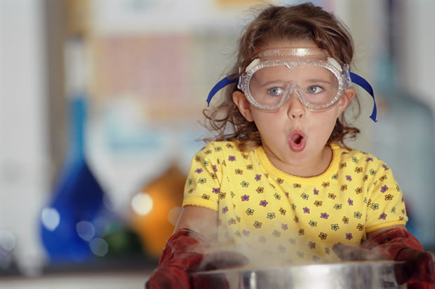 Young girl exploring chemistry